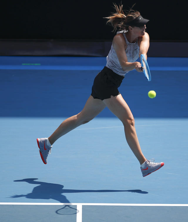 Russia's Maria Sharapova hits a backhand return during a practice session ahead of the Australian Open tennis championship in Melbourne, Australia, Sunday, Jan. 19, 2020. (AP Photo/Andy Wong)