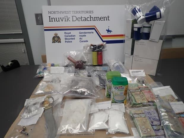 RCMP searched Talal Khatib's home in 2017. They found about 500 grams of marijuana, 50 grams of crack cocaine, and 300 grams of powdered cocaine, over $25,000 of cash and restricted weapons, police said.  (Inuvik RCMP - image credit)