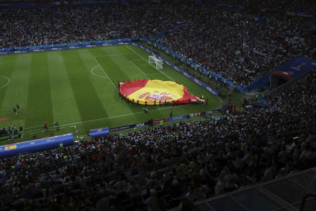 Spain's flag is carried off the field after opening ceremonies at the group B match between Iran and Spain at the 2018 soccer World Cup in the Kazan Arena in Kazan, Russia, Wednesday, June 20, 2018. (AP Photo/Eugene Hoshiko)