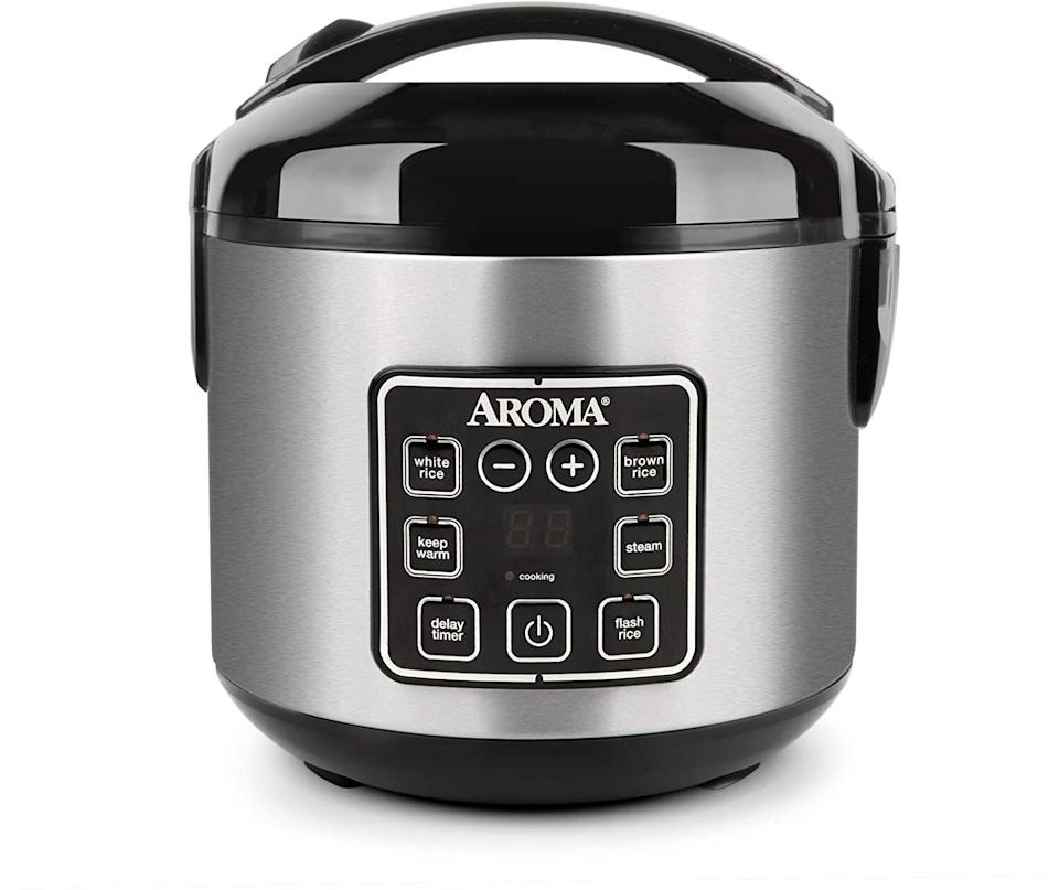 """You can make 8 cups of rice in this, and then neatly pop it into the dishwasher when you're done. It also comes with a built-in steamer, so if you're like, """"Get this bread! But also these veggies!!"""" you can prep them at the same time.<br /><br /><strong>Promising review:</strong>""""I'd like to say I'm a decent cook and pretty good baker. I can make recipes from scratch and they turn out very well. I love baking more than anything. With that being said, I can NOT make rice on the stove for the life of me. Probably not a bad thing since I dislike rice, but I'm trying to get used to it.<strong>This rice cooker is a godsend when it comes to cooking rice</strong>. Add water, add rice, add some flavorings if need be, and BAM!<strong>Press a button and walk away.</strong>"""" —<a href=""""https://www.amazon.com/gp/customer-reviews/R34NCITODMHRBP?ASIN=B007WQ9YNE&ie=UTF8&linkCode=ll2&tag=huffpost-bfsyndication-20&linkId=6f77043285cb67b2503371884dbf12b1&language=en_US&ref_=as_li_ss_tl"""" target=""""_blank"""" rel=""""noopener noreferrer"""">Baby Stego</a><br /><br /><strong>Get it from Amazon for<a href=""""https://www.amazon.com/Aroma-Housewares-UNCOOKED-Digital-ARC-914D/dp/B007WQ9YNE?&linkCode=ll1&tag=huffpost-bfsyndication-20&linkId=232f61e2ead604c9bb22bf2bdb6fb535&language=en_US&ref_=as_li_ss_tl"""" target=""""_blank"""" rel=""""noopener noreferrer"""">$29.92</a>(available in two styles).</strong>"""