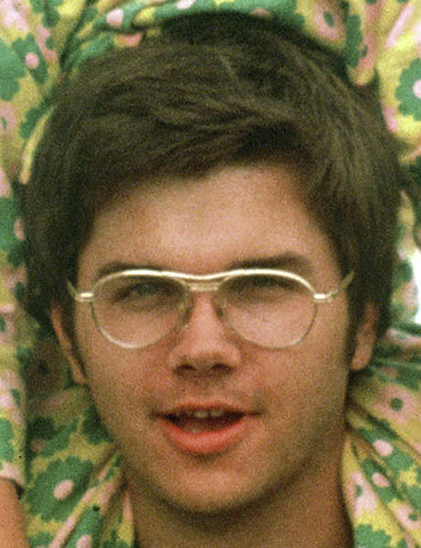 FILE - In this 1975 file photo, Mark David Chapman is seen at Fort Chaffee near Fort Smith, Ark.  New York Department of Corrections spokeswoman Linda Foglia says Chapman, who shot former Beatle John Lennon to death in 1980, is scheduled to be interviewed by members of the parole board during the week of Aug. 20, 2012.  This will be the seventh time Chapman will seek parole. (AP Photo/Greg Lyuan, File)