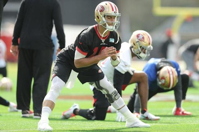 Jimmy Garoppolo practices with his San Francisco team-mates ahead of Sunday's Super Bowl in Miami (AFP Photo/Michael Reaves)