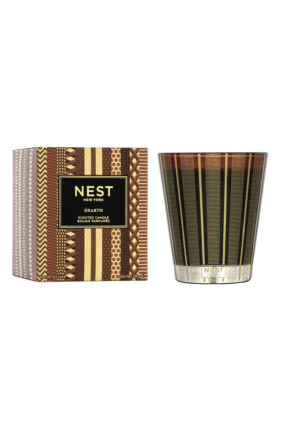 """<h3>Nest Fragrances Hearth Candle</h3><br>This festive votive said to contain """"the aroma of a wintertime fire"""" is infused with rich oud wood with frankincense and hints of smoky embers. <br><br><strong>NEST New York</strong> Hearth Scented Candle, $, available at <a href=""""https://go.skimresources.com/?id=30283X879131&url=https%3A%2F%2Fwww.nordstrom.com%2Fs%2Fnest-new-york-hearth-scented-candle-limited-edition%2F5731674"""" rel=""""nofollow noopener"""" target=""""_blank"""" data-ylk=""""slk:Nordstrom"""" class=""""link rapid-noclick-resp"""">Nordstrom</a>"""