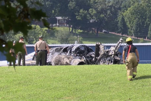 The burned remains of a plane that was carrying NASCAR television analyst and former driver Dale Earnhardt Jr. lies near a runway Thursday, Aug. 15, 2019, in Elizabethton, Tenn. (WJHL TV via AP)