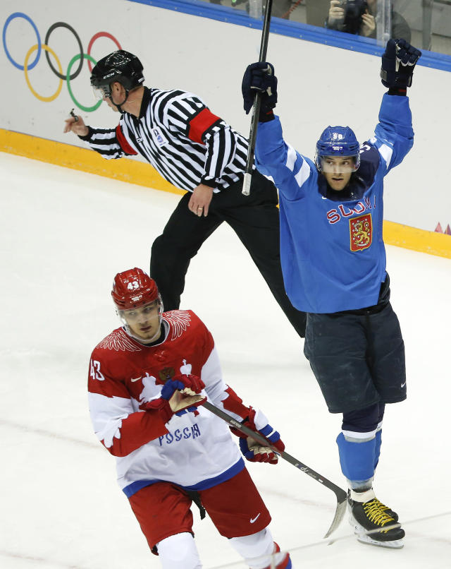 Finland forward Juhamatti Aaltonen, right, and Russia forward Valeri Nichushkin react after Finland scored a goal in the first period of a men's quarterfinal ice hockey game at the 2014 Winter Olympics, Wednesday, Feb. 19, 2014, in Sochi, Russia. (AP Photo/Mark Humphrey)