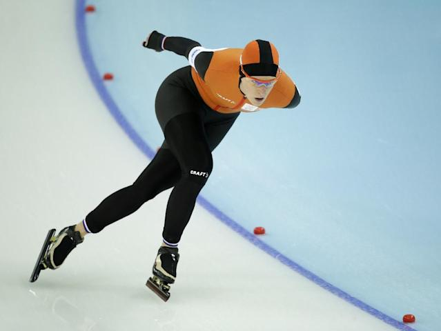 Ireen Wust of the Netherlands competes in the women's 5,000-meter speedskating race at the Adler Arena Skating Center during the 2014 Winter Olympics in Sochi, Russia, Wednesday, Feb. 19, 2014. (AP Photo/Patrick Semansky)
