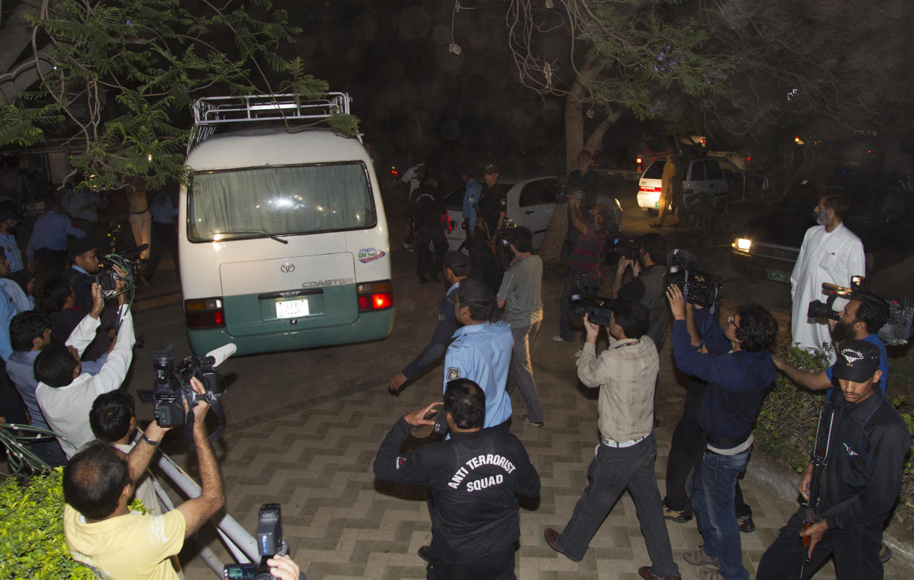 Media chase a minivan carrying the family of Osama bin Laden, in Islamabad, Pakistan on Thursday, April 26, 2012. A minivan carrying the three widows and children of Bin Laden has left the house where they have been staying in Islamabad and is en route to the airport, from where they will be deported to Saudi Arabia, officials and witness said. (AP Photo/B.K. Bangash)