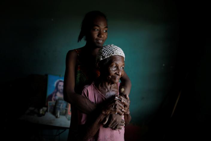 Aidalis Guanipa, 25, a kidney disease patient, poses for a photo with her 83-year-old grandmother, while they wait for the electricity to return, at her house during a blackout in La Concepcion, Venezuela. (Photo: Ueslei Marcelino/Reuters)