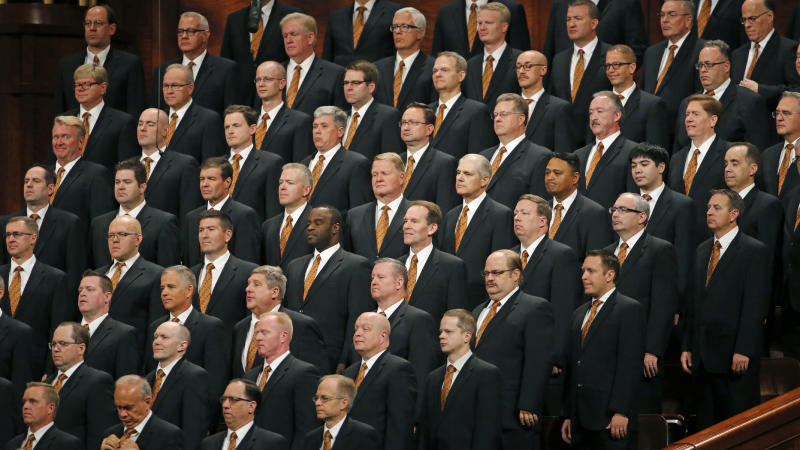 FILE - In this Oct. 5, 2019, file photo, members of The Tabernacle Choir at Temple Square look on during The Church of Jesus Christ of Latter-day Saints' twice-annual church conference, in Salt Lake City. For the first time in more than 60 years, top leaders from The Church of Jesus Christ of Latter-day Saints will deliver speeches at the faith's signature conference this weekend without anyone watching in the latest illustration of how the coronavirus pandemic is altering worship practices around the world. The twice-yearly conference normally brings some 100,000 people to the church conference center in Salt Lake City to watch five sessions over two days. This event, though, will be only a virtual one. (AP Photo/Rick Bowmer, File)