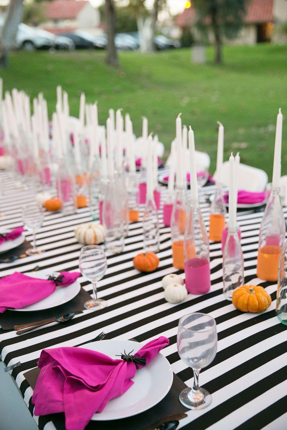 "<p>Have an outdoor Halloween dinner party? A <a href=""https://www.amazon.com/LinenTablecloth-70-Inch-Polyester-Tablecloth-Checker/dp/B008TLCX66?&tag=housebeautiful_auto-append-20&ascsubtag=[artid
