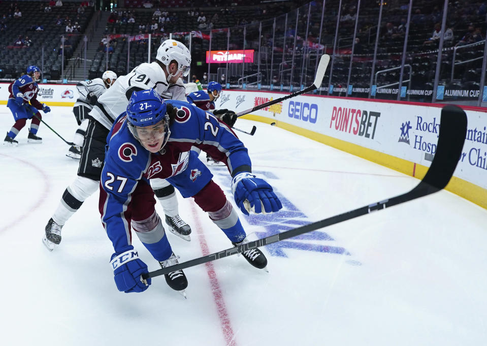 Los Angeles Kings left wing Carl Grundstrom (91) pushes down Colorado Avalanche defenseman Ryan Graves (27) during the first period of an NHL hockey game Thursday, May, 13, 2021, in Denver. (AP Photo/Jack Dempsey)