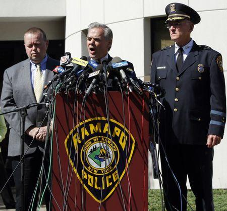 FILE PHOTO: Ramapo Supervisor Christopher St. Lawrence (C) speaks to members of the media along with Ramapo Chief of Police Peter Brower (R) and Detective Brad Weidel in Ramapo, New York May 6, 2010.