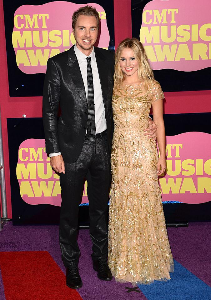 "<p class=""MsoNormal"">She may not have much to do with country music, but the always likable Kristen Bell (who says she's a big fan of the genre) was tapped to co-host this year's show along with Toby Keith. The 5'1"" blonde looked lovely in a gold gown … and with fiancé Dax Shepherd on her arm, of course! <span style="""">But what was with his shiny suit? <br></span></p>"