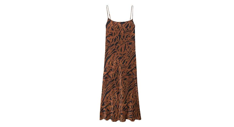 "<p>Everyone's favourite dress brand are jumping on the unavoidable animal print trend with this cute slip. Dress it up with heels for dinner, or down with trainers for a Saturday traipsing round the shops… <br><a href=""https://www.rixo.co.uk/product/holly-brown-tiger-stripe/"" rel=""nofollow noopener"" target=""_blank"" data-ylk=""slk:Buy here."" class=""link rapid-noclick-resp"">Buy here.</a> </p>"