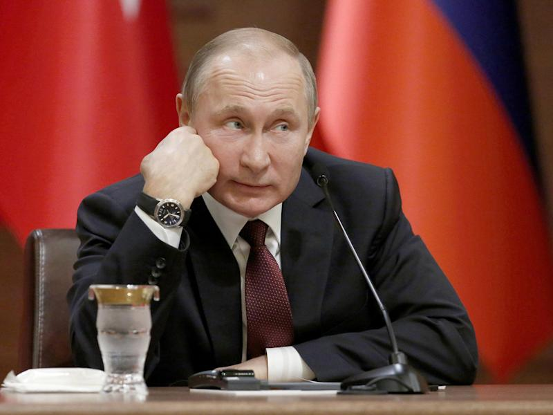 Vladimir Putin has denied sponsoring cyber attacks around the world: EPA