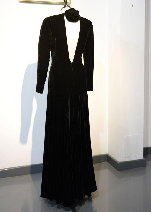 A Bruce Oldfield black velvet evening gown, worn for the official portrait by Lord Snowdon and for the first night gala opening of 'Les Miserables' at the Barbican Centre and 10th October 1985 is displayed at a photocall ahead of the the 'Fit For a Princess' auction on March 15, 2013 in London, England. 10 dresses from the collection of Diana, Princess of Wales are to be auctioned by specialist Kerry Taylor. (Photo by Karwai Tang/WireImage)