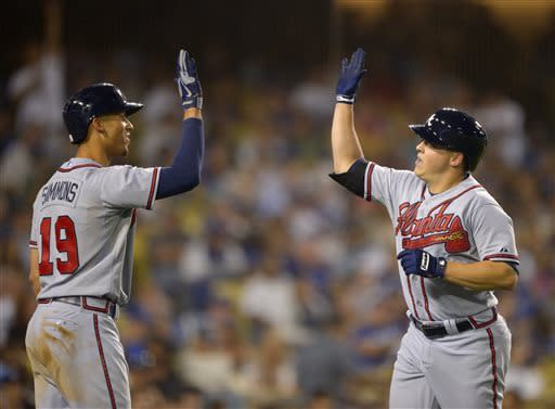 Atlanta Braves' Kris Medlen, right, his congratulated by Andrelton Simmons after hitting a solo home run during the fifth inning of a baseball game against the Los Angeles Dodgers, Saturday, June 8, 2013, in Los Angeles. (AP Photo/Mark J. Terrill)