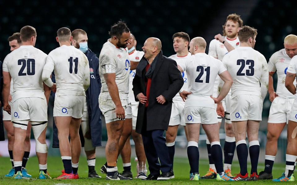 England's head coach Eddie Jones celebrates with England's Billy Vunipola after the Six Nations rugby union match between England and France at Twickenham - Exclusive: England's summer Tests to be broadcast live on terrestrial television for first time since 1997 - AP