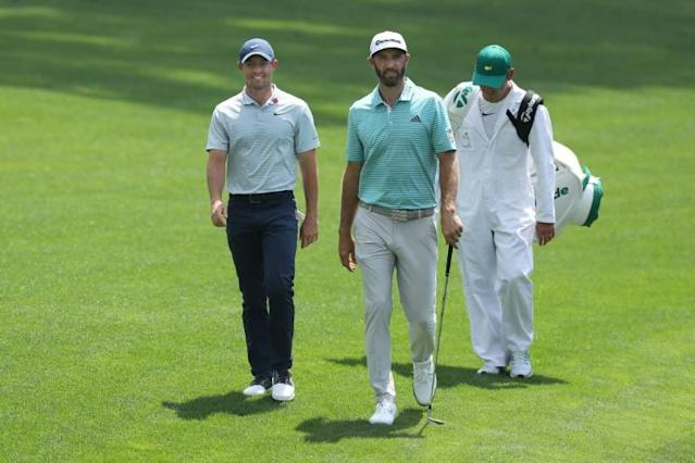 McIlroy and Johnson will team up in a charity event on May 17 (AFP Photo/DAVID CANNON)