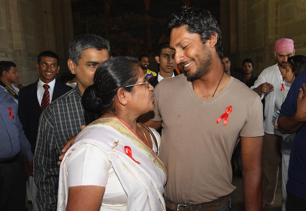 KANDY, SRI LANKA - MARCH 08:  Kumar Sangakkara, captain of Sri Lanka (R) speaks to his former teacher during his return to Trinity College to promote 'Think Wise' a campaign with UNAIDS, UNICEF and the ICC on March 8, 2011 in Kandy, Sri Lanka.  (Photo by Michael Steele/Getty Images)