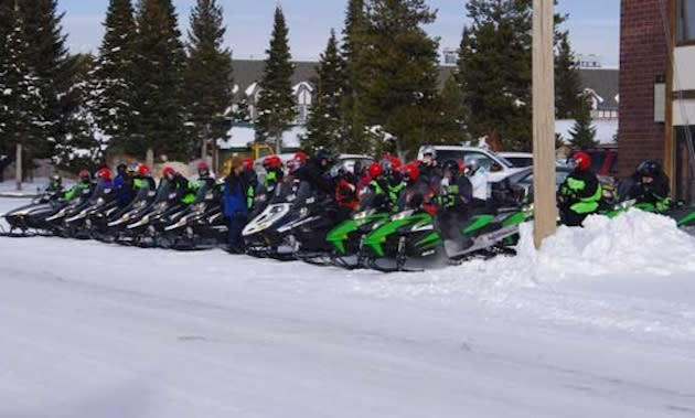 West Yellowstone basketball fans mount their snowmobiles for a cross-park trek to Gardiner High — Facebook