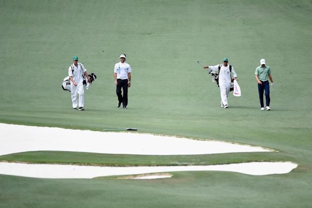AUGUSTA, GA - APRIL 13: Bubba Watson and Jordan Spieth of the United States walk with their caddies on the tenth hole during the final round of the 2014 Masters Tournament at Augusta National Golf Club on April 13, 2014 in Augusta, Georgia. (Photo by Harry How/Getty Images)