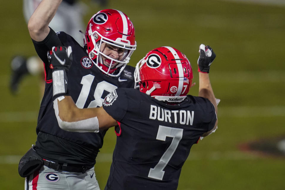 Georgia Bulldogs wide receiver Jermaine Burton (7) reacts with quarterback JT Daniels (18) after connecting on a long touchdown pass against Mississippi State. (Dale Zanine-USA TODAY Sports)