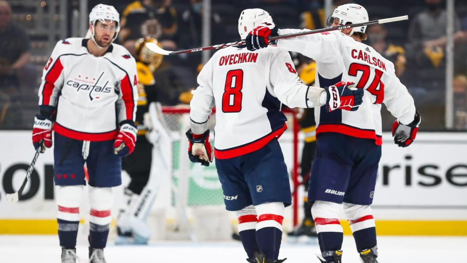 Alex Ovechkin celebrates with teammates Tom Wilson and John Carlson after scoring. (Photo by Adam Glanzman/Getty Images)