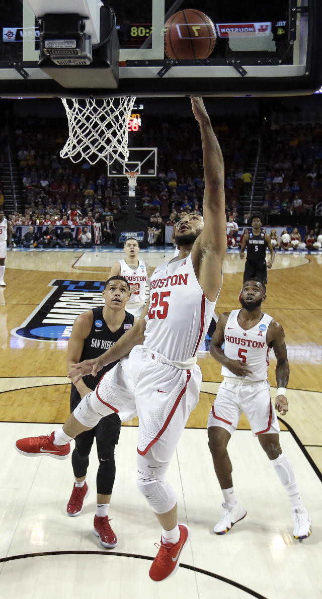 Houston guard Galen Robinson Jr., (25) puts up a shot during the first half of an NCAA men's college basketball tournament first-round game against San Diego State Thursday, March 15, 2018, in Wichita, Kan. (AP Photo/Charlie Riedel)