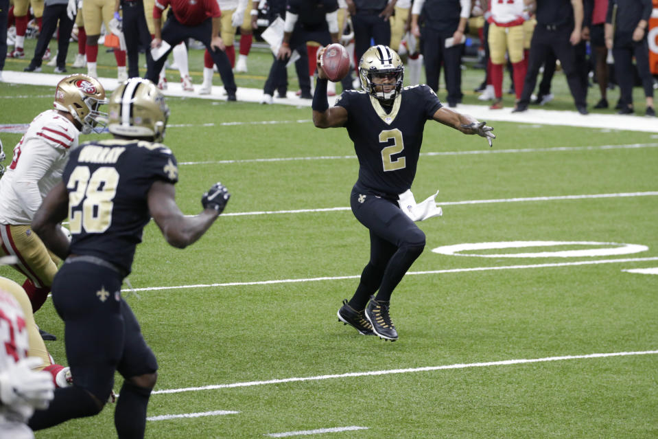 New Orleans Saints quarterback Jameis Winston (2) pump fakes while running for a short gain near the goal line in the second half of an NFL football game against the San Francisco 49ers in New Orleans, Sunday, Nov. 15, 2020. (AP Photo/Butch Dill)