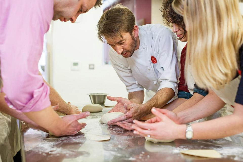 """<p>Prefer eating to moving? Fair enough, no judgement here. But why not learn how to whip up a gastropub-worthy feast of your very own with a 30-60 minute lunchtime cookery class at <a rel=""""nofollow noopener"""" href=""""https://www.atelierdeschefs.co.uk"""" target=""""_blank"""" data-ylk=""""slk:Atelier des Chefs"""" class=""""link rapid-noclick-resp"""">Atelier des Chefs</a>, London's most popular cookery school? Classes take place at Oxford Circus and St. Paul's, and cover everything from gourmet burgers to Thai street food. Once you've learned how to put a Michelin star-worthy packed lunch together, though, what are you going to do with that spare hour? Well, you could always learn Mandarin… Get a group of 6-12 colleagues together and the <a rel=""""nofollow noopener"""" href=""""http://www.languagesatlunch.com/classes/"""" target=""""_blank"""" data-ylk=""""slk:Languages at Lunch"""" class=""""link rapid-noclick-resp"""">Languages at Lunch</a> team will come to your workplace to teach you Spanish, French, German, Italian or – yes – even Mandarin. Well, it beats 15 minutes on Candy Crush, doesn't it? </p>"""