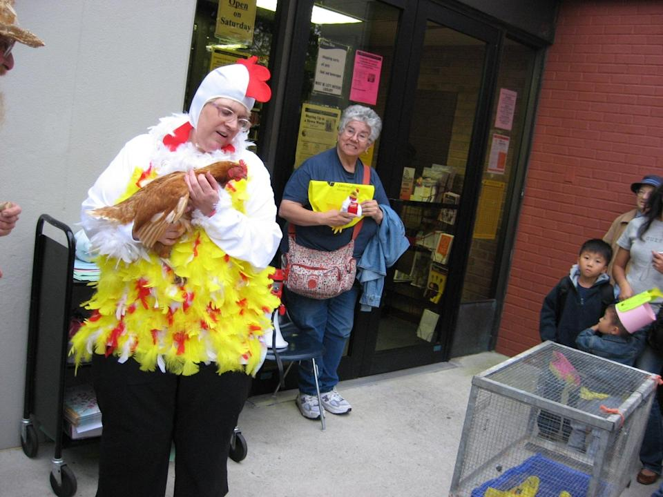 """<div class=""""caption-credit""""> Photo by: Queens Library</div><b>2009 Challenge: Read 2,500 books <br> Final Results: 5,800 books</b> <br> """"I bought a sweatshirt at Walmart and glued feathers to it, then performed the 'Chicken Dance' four times next to a live chicken,"""" says Scatena. """"Our local Kentucky Fried Chicken donated 200 meals to the event."""""""