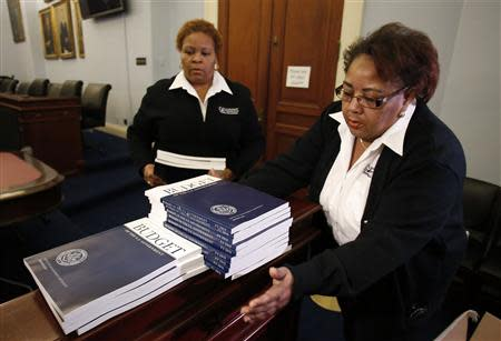 U.S. Government Printing Office employees deliver copies of President Barack Obama's Fiscal Year 2015 Budget to The House Budget Committee on Capitol Hill in Washington, March 4, 2014. REUTERS/Yuri Gripas