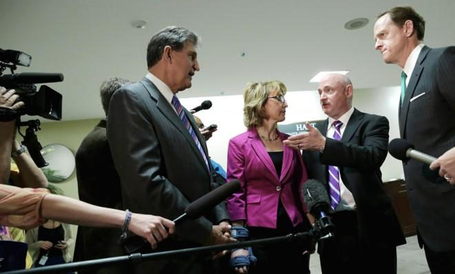 Gabby Giffords and her husband Mark Kelly meet with Sens. Joe Manchin (D-W.V) and Pat Toomey (R-Pa.) on April 16.