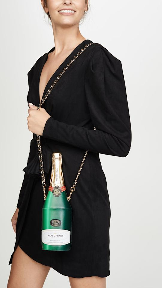 "<p>Bring the party with this <a href=""https://www.popsugar.com/buy/Moschino-Bottle-Bag-497687?p_name=Moschino%20Bottle%20Bag&retailer=shopbop.com&pid=497687&price=950&evar1=fab%3Aus&evar9=36097844&evar98=https%3A%2F%2Fwww.popsugar.com%2Ffashion%2Fphoto-gallery%2F36097844%2Fimage%2F47010838%2FMoschino-Bottle-Bag&list1=shopping%2Cgifts%2Ctrends%2Choliday%2Cstreet%20style%2Cwinter%2Cgift%20guide%2Cwinter%20fashion%2Choliday%20fashion%2Cfashion%20gifts%2Cgifts%20for%20women&prop13=api&pdata=1"" rel=""nofollow"" data-shoppable-link=""1"" target=""_blank"" class=""ga-track"" data-ga-category=""Related"" data-ga-label=""https://www.shopbop.com/bottle-bag-moschino/vp/v=1/1576882244.htm?folderID=13198&amp;fm=other-shopbysize-viewall&amp;os=false&amp;colorId=64031"" data-ga-action=""In-Line Links"">Moschino Bottle Bag</a> ($950).</p>"