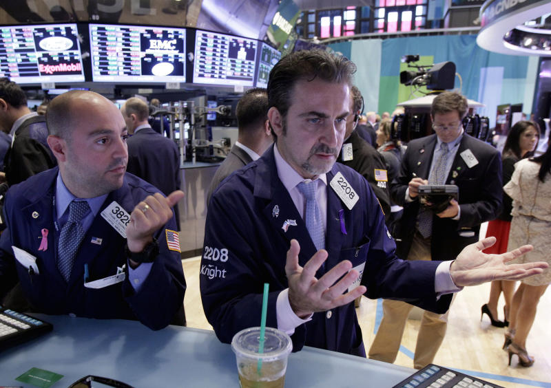 Specialists Frank Babino, left, and Jason Blatt work at the post that trades Pandora on the floor of the New York Stock Exchange Friday, Sept. 7, 2012. Stocks are opening mixed on Wall Street following news that the U.S. economy added fewer jobs than expected in August. (AP Photo/Richard Drew)