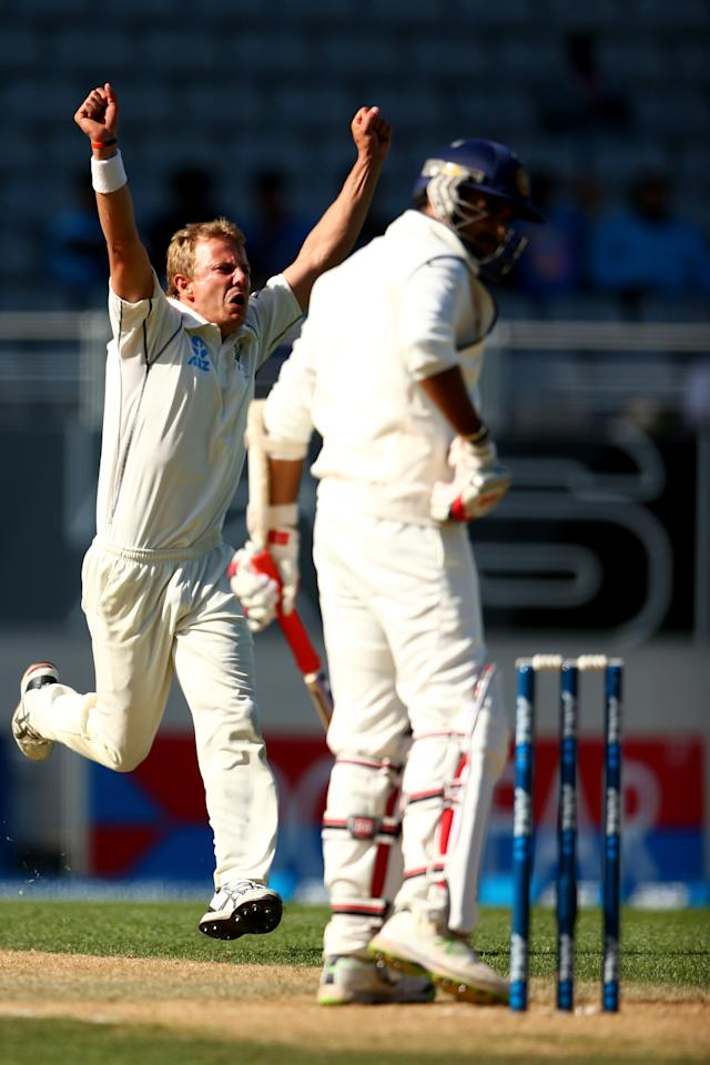 AUCKLAND, NEW ZEALAND - FEBRUARY 09:  Neil Wagner of New Zealand celebrates his wicket of Zaheer Khan of India (R) during day four of the First Test match between New Zealand and India at Eden Park on February 9, 2014 in Auckland, New Zealand.  (Photo by Phil Walter/Getty Images)