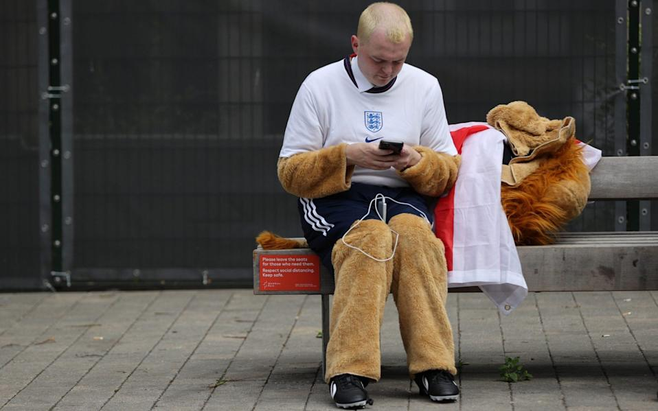 Czech Republic v England, a man in a lion costume prepares to support his team - Reuters