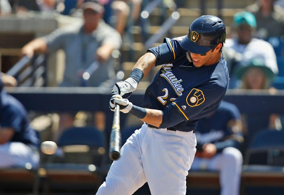 Milwaukee Brewers' Christian Yelich grounds out in the first inning of a spring training baseball game against the Texas Rangers Tuesday, March 19, 2019, in Phoenix (AP Photo/Sue Ogrocki)