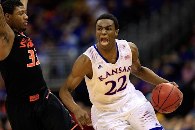 Andrew Wiggins of the Kansas Jayhawks drives upcourt as Marcus Smart of the Oklahoma State Cowboys defends during the Big 12 Basketball Tournament quarterfinal game at Sprint Center on March 13, 2014 in Kansas City, Missouri (AFP Photo/Jamie Squire)
