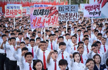 "An anti-U.S. rally at Kim Il Sung Square is seen in this September 23, 2017 photo released by North Korea's Korean Central News Agency (KCNA) in Pyongyang on September 24, 2017.  Placards read (L-R) ""A global military power"", ""Be through with the U.S."", ""The U.S. is evil's headquarters"", ""Old foe the U.S.""  KCNA/via REUTERS"
