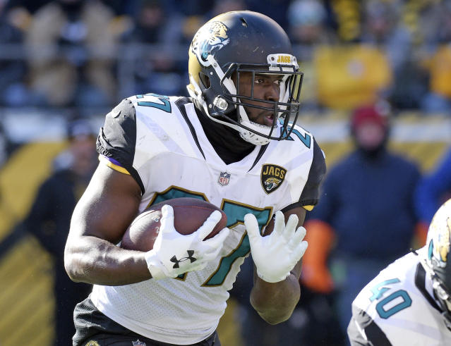 FIle - In this Jan. 14, 2018, file photo, Jacksonville Jaguars running back Leonard Fournette (27) carries the ball during the first half of an NFL divisional football AFC playoff game against the Pittsburgh Steelers in Pittsburgh. The Jaguars have ruled out Fournette for their game at Dallas. It will be the fourth game Fournette has missed this season. (AP Photo/Don Wright, File)