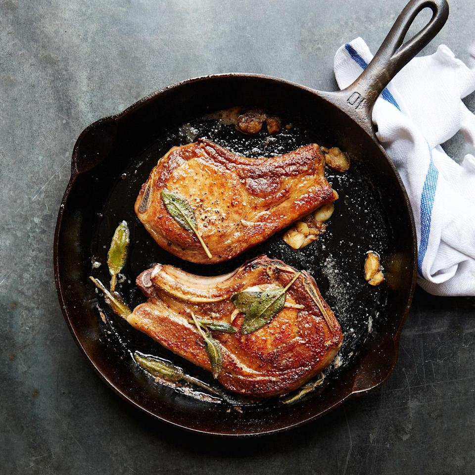 """Pork chops feel fancy but (shhhh) they're super-easy to make. Celebrate the end of a long day with this thoroughly unfussy, yet festive dish. <a href=""""https://www.epicurious.com/recipes/food/views/your-new-favorite-pork-chops-51264230?mbid=synd_yahoo_rss"""" rel=""""nofollow noopener"""" target=""""_blank"""" data-ylk=""""slk:See recipe."""" class=""""link rapid-noclick-resp"""">See recipe.</a>"""