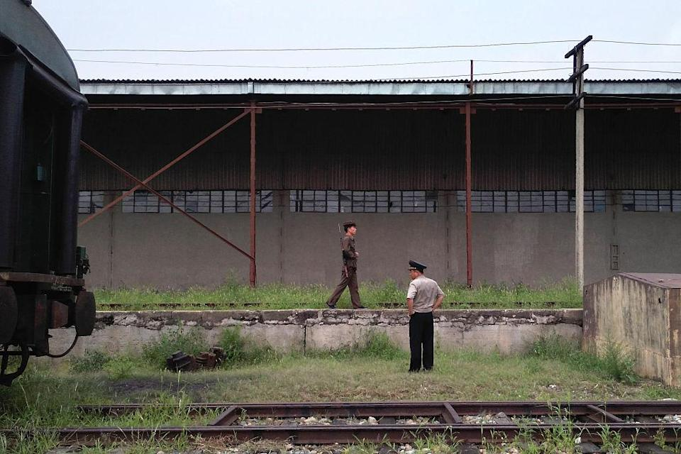<p>Korean People's Army soilders guard Tumangang railway station in Tumangang. It has 5,889,000 paramilitary personnel, it is the largest paramilitary organization on Earth. This number represents 25% of the North Korean population. (Getty) </p>