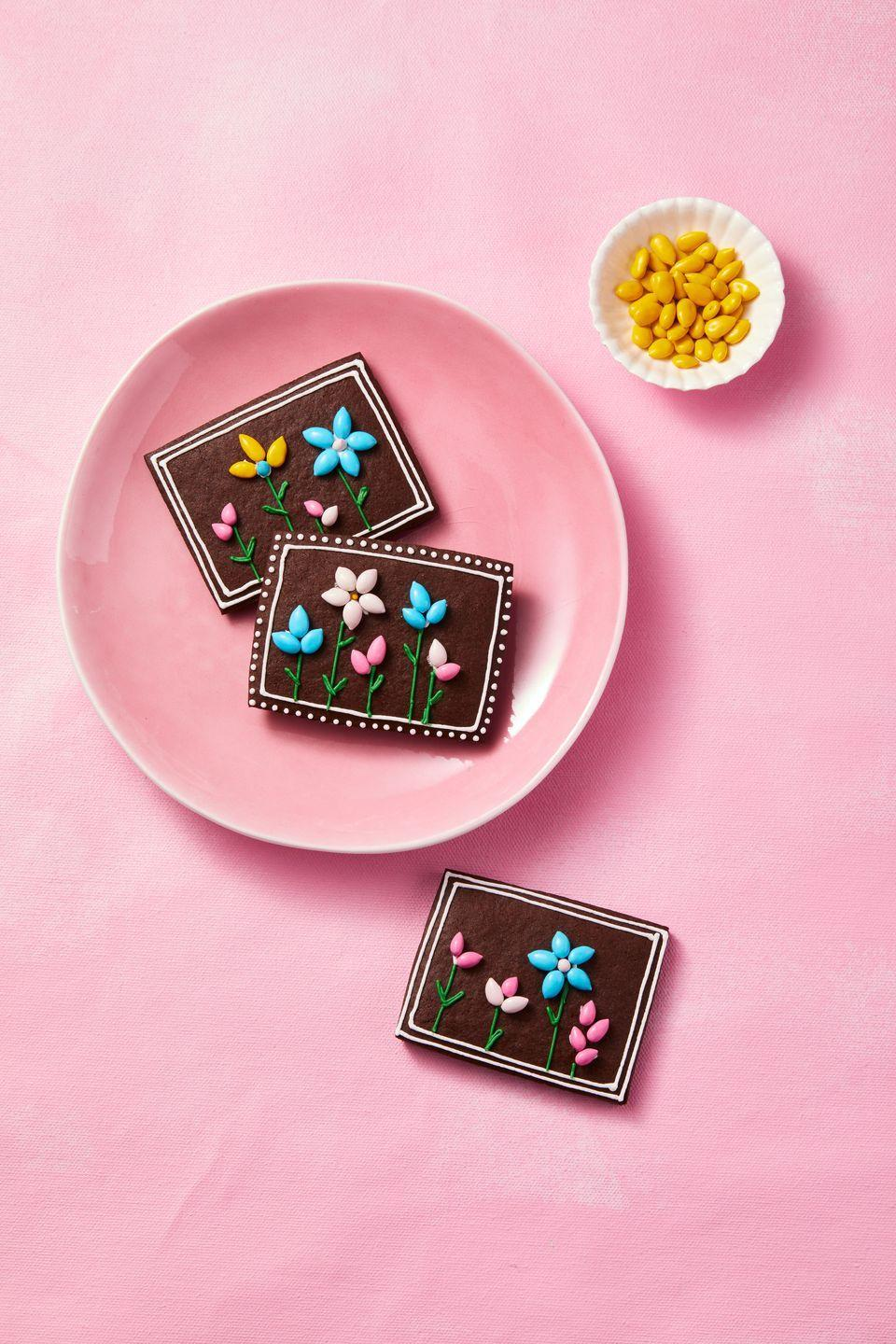 "<p>Decorate baked <a href=""https://www.goodhousekeeping.com/food-recipes/a35396698/chocolate-sugar-cookies-recipe/"" rel=""nofollow noopener"" target=""_blank"" data-ylk=""slk:chocolate sugar cookie"" class=""link rapid-noclick-resp"">chocolate sugar cookie</a> rectangles with icing, then attach <a href=""https://go.redirectingat.com?id=74968X1596630&url=https%3A%2F%2Fnuts.com%2Fchocolatessweets%2Fcolor-chocolates%2Fsunflower-seeds%2F%3FrefinementList%255BProduct.searchableTags%255D%255B0%255D%3Dchocolates%2B%2526%2Bsweets&sref=https%3A%2F%2Fwww.goodhousekeeping.com%2Fholidays%2Feaster-ideas%2Fg26557097%2Feasy-easter-desserts%2F"" rel=""nofollow noopener"" target=""_blank"" data-ylk=""slk:candy-coated sunflower seeds"" class=""link rapid-noclick-resp"">candy-coated sunflower seeds</a>.</p>"