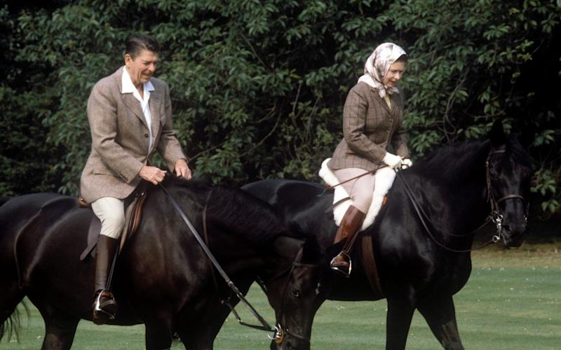 The Queen riding with Ronald Reagan in June 1982 - Hulton