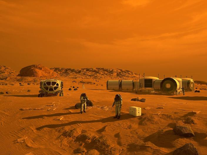 An artist's concept of astronauts and human habitats on Mars.