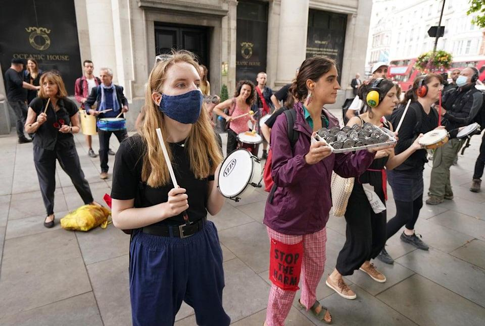 Demonstrators during a protest at the Brazilian Embassy, London, by members of Extinction Rebellion, Amazon Rebellion, Brazil Matters, CAFOD, Greenpeace, Parents for Future and Survival International. (Dominic Lipinski/PA) (PA Wire)