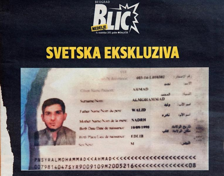 A photo taken in Belgrade on November 15, 2015 shows the front page of Serbian magazine Blic, displaying a Syrian passport issued to asylum seeker Ahmad alMohammad and found by police at the scene of one of the Paris attacks