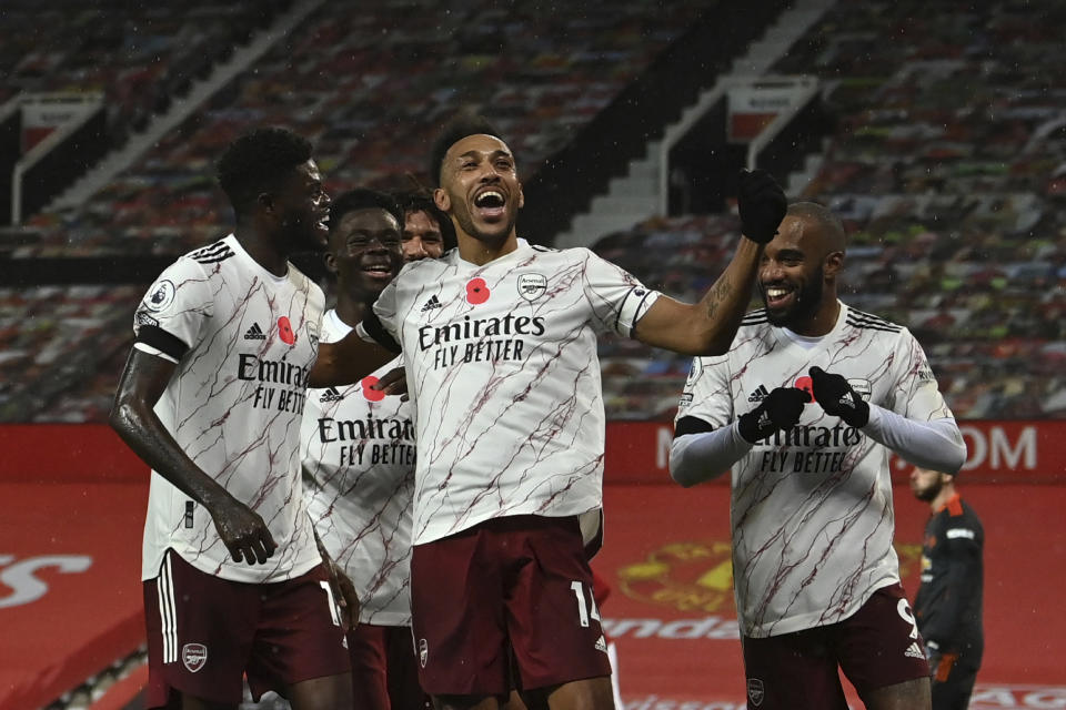 Arsenal's Pierre-Emerick Aubameyang celebrates after scoring his side's opening goal during the English Premier League soccer match between Manchester United and Arsenal at the Old Trafford stadium in Manchester, England, Sunday, Nov. 1, 2020. (Paul Ellis/Pool via AP)